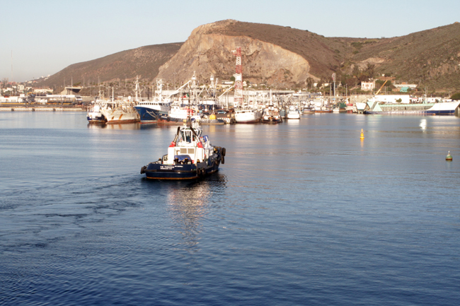 morning in ensenada, the tugboat is leaving